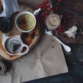 Cup of tea, jam and winter decorations — Stock Photo