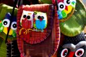 Two owls sewn into a bag for sale — Stock Photo