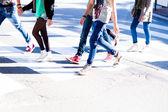 Boys crossing the pedestrian crossing — Stock Photo