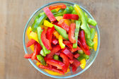 Colored peppers mixed in a bowl — Stock Photo