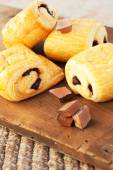 Chocolate croissants on wooden background — ストック写真