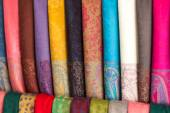 Rows of different brightly colored fabrics — Stock Photo