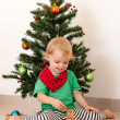 Little girl playing near the christmas tree — Stock Photo #58763821