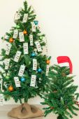 Christmas tree decorated with dollars notes — Stock Photo