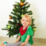 Little girl posing near the christmas tree — Stock Photo #59004757