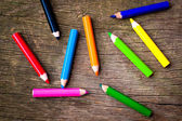 Bright pencils on wooden background — Stock Photo