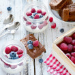 Healthy breakfast with yogurt, raspberries and blueberries — Stockfoto #68342195