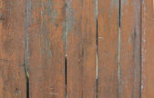 Part of wooden door painted in orange and have grown old — Stock Photo