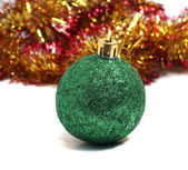Christmas ball on green background of holiday decorations — Stock Photo