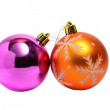 Two Christmas balls of orange and green on white — Stock Photo #58589459
