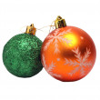 Two Christmas balls of orange and green on white — Stock Photo #58589483