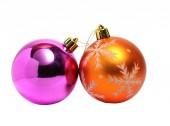 Two Christmas balls of orange and green on white — Stock Photo
