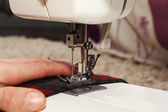Sewing at home sewing machine — Stock Photo