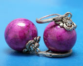 Big silver earrings with purple stone — Stock Photo
