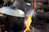 Soup cooking in a pot on the fire — Stok fotoğraf