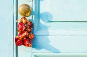 Red hot dried peppers hanging on a door — Stock Photo