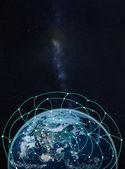 Глобальная сеть на земле--элементы этого изображения, предоставляемая Na — Стоковое фото