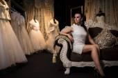 Bride chooses a dress — Stock Photo