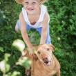 Handsome Young Boy and His Dog looking up — Stock Photo #53519431