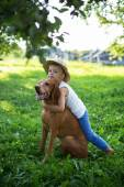 Handsome Young Boy Playing with His Dog at the park — Stock Photo