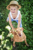 Handsome Young Boy and His Dog looking up — Stock Photo