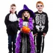 One little girl and two boys dressed the Halloween costumes: witch, skeleton, vampire — Photo #55525275