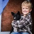 Smiling beautiful blond kid and his dog. Boy and basenji — Stock Photo #55681099