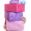 Beautiful woman's hands holding a colorful gift boxes with ribbon — Stock Photo #57862823