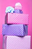 Colorful gift boxes with ribbon over pink background. Pink, purple, pastel, bright — Stock Photo