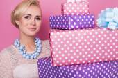 Woman with colorful jewelry holding big and small present boxes. Soft colors. Christmas, birthday, Valentine day — Stock Photo