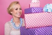 Woman with big beautiful smile holding colorful gift boxes. Soft colors. Christmas, birthday, Valentine day, presents — Stock Photo