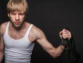 Angry man threatens with belt. Concept: Violence in the family — Stock Photo