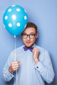 Attractive young man with a blue balloon in his hand. Party, birthday, Valentine — Stock Photo