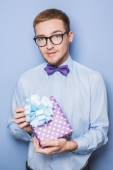 Young caucasian man holding colorful gift. Present, birthday, Valentine — Stock Photo