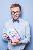 Handsome young man with a gift box. Present, birthday, Valentine — Stock Photo