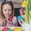 Easter, family, holiday and child concept - close up of little girl and mother coloring eggs for Easter — Stock Photo #67638723