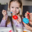 Easter, family, holiday and child concept - close up of little girl and mother coloring eggs for Easter — Stock Photo #67638725
