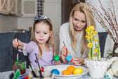 Mother And Daughter Painting Easter Eggs In Home — Стоковое фото