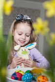 Smiling cute child with easter eggs and plush bunny. Easter — Stock Photo