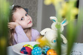 Smiling cute kid with easter eggs and plush bunny. Easter — Stock Photo