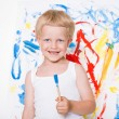 Artist preschool boy painting brush watercolors on a easel. School. Education. Creativity. Studio portrait over white background — Zdjęcie stockowe #77460996