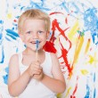 Artist preschool boy painting brush watercolors on a easel. School. Education. Creativity. Studio portrait over white background — Zdjęcie stockowe #77461022