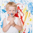 Artist preschool boy painting brush watercolors on a easel. School. Education. Creativity. Studio portrait over white background — Zdjęcie stockowe #77461030