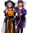 Witch children with trick or treat. Halloween. Fairy. Tale. Studio portrait isolated over white background — Stock Photo #78917148