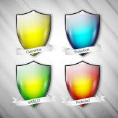 Empty isolated colored shields on dirty gray background. Vector format — Stock Vector