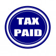 Tax paid white stamp text on blueblack — Stock Photo #70229233