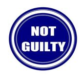 Not guilty white stamp text on blueblack — Stock Photo
