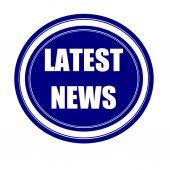 Latest news white stamp text on blueblack — Stock Photo