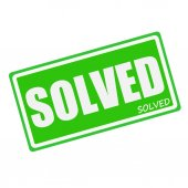 SOLVED white stamp text on green — Stock Photo