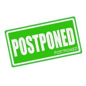 POSTPONED white stamp text on green — Stock Photo